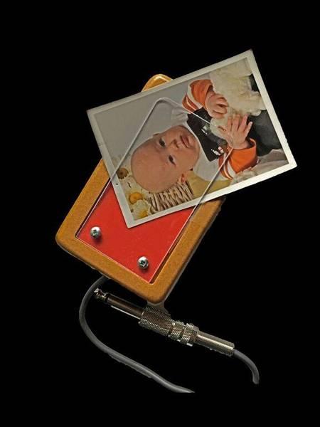 Minibryter med lomme for bilder